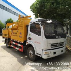 Asphalt road pothole patcher repair truck