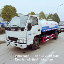 JMC 1200 gallon water spray truck