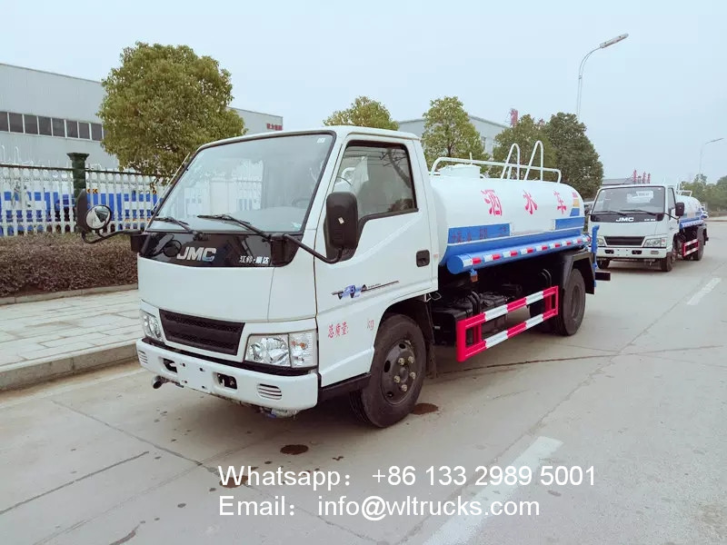 JMC 1200 gallon water spray truck