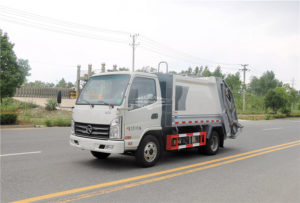Rear loading garbage compactor truck