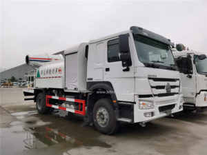 HOWO 3000 gallon dust suppression truck with 80m fog cannon